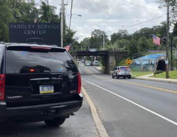 Yardley police vehicles are seen blocking off a street