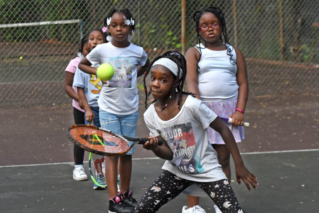 Melani Thompson, 10, learns how to play tennis in Camden on Aug. 26, 2021