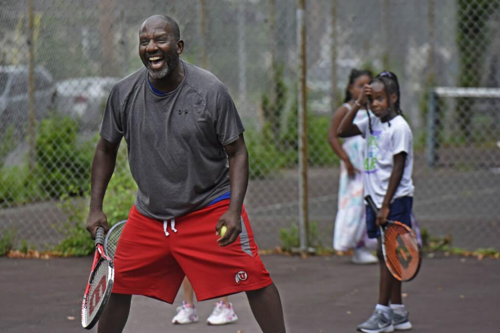 Orlando Council-Pettigrew helps teach girls how to play tennis in Camden On Aug. 16, 2021