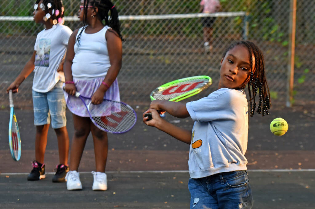 Harlem Lewis, 6, hits the ball at Simbas Tennis on August 26, 2021