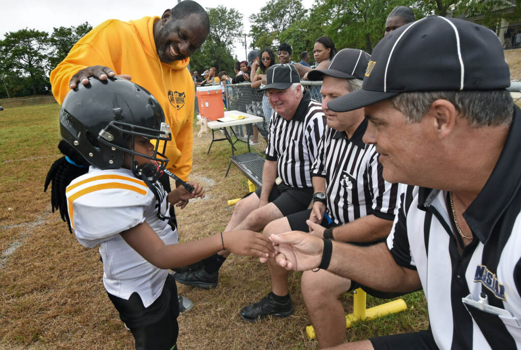 """At a Simbas game in September 2016, coach Orlando Council-Pettigrew introduces Janiyah (""""Icebox"""") Hill to the referees"""