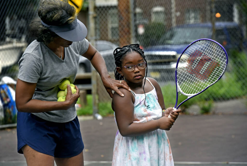 Kelly Cass-White gives pointers to Jeyla Long, 7, in Camden on Aug. 26, 2021