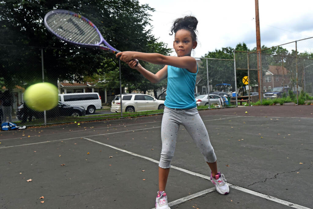 Mariah El, 8, hits the ball during tennis class in Camden on Aug. 16, 2021