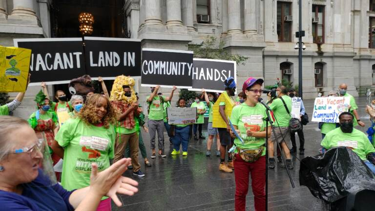 Protesters outside City Hall calling for vacant land to be given for community development