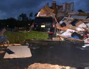 A damaged home in the wake of a possible tornado