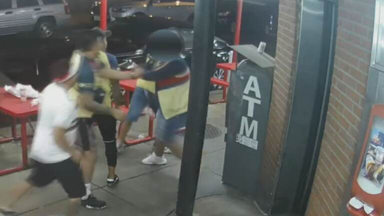 An image from security footage shows alleged suspects in the fatal beating