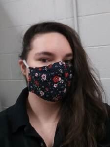 Rachel Baker wears a face mask