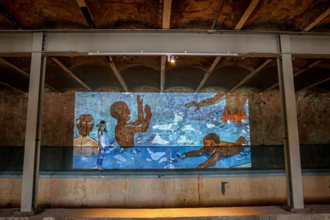 Curator Victoria Prizzia steps into a projection