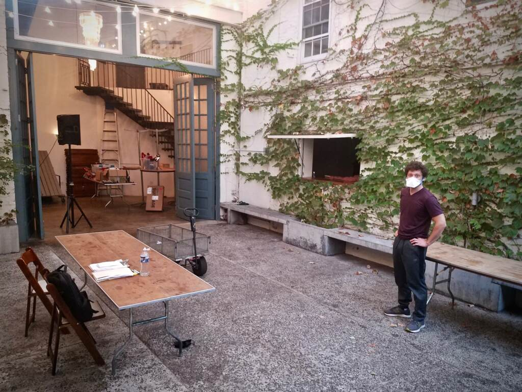 Man stands in theater patio