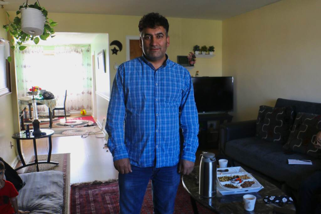 Mohammed Sadeed stands inside his living room