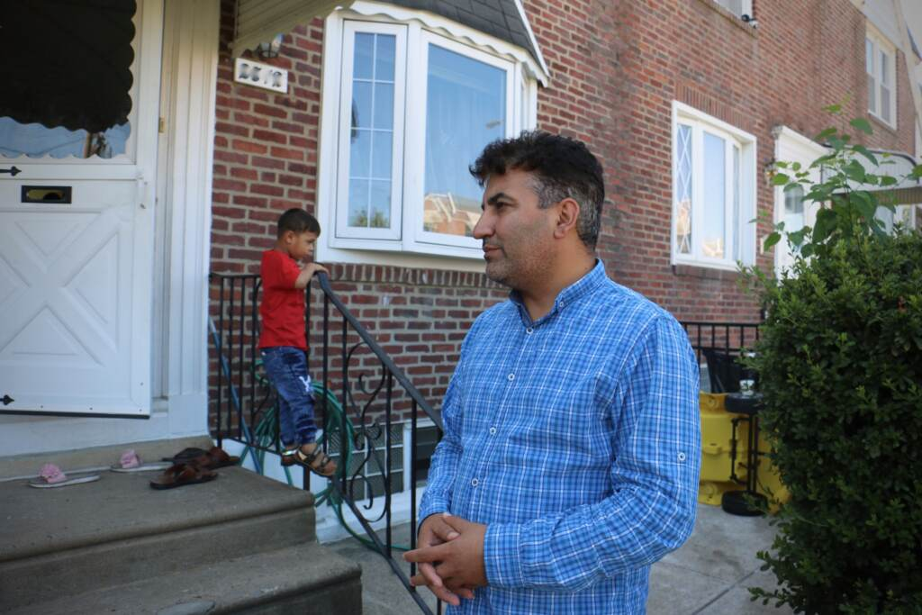 Mohammed Sadeed stands outside his home