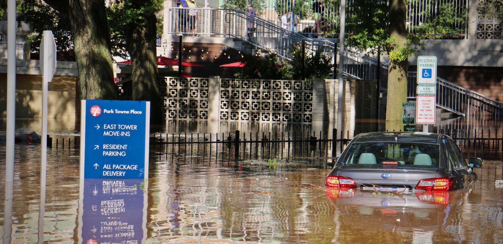 Vehicle is submerged in floodwater in Center City
