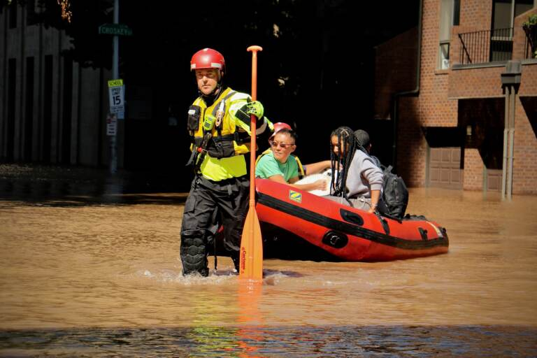 Fire Department rescue teams assist residents via raft