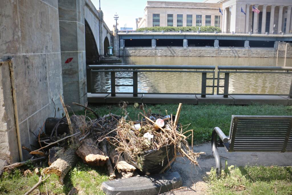 Debris stacked in a pile along the Schuylkill River Trail