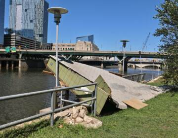 The roof of a shed rests on a railing along the Schuylkill River Trail