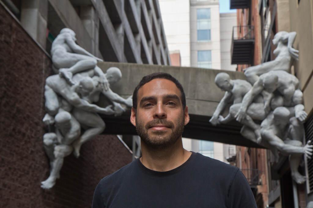 Artist Miguel Antonio Horn with his aluminum-plated sculpture