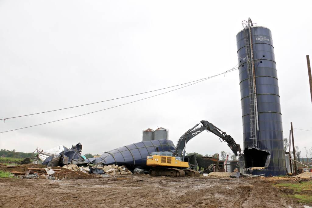 Workers prepare to pull down the one grain silo still standing at Wellacrest Farms