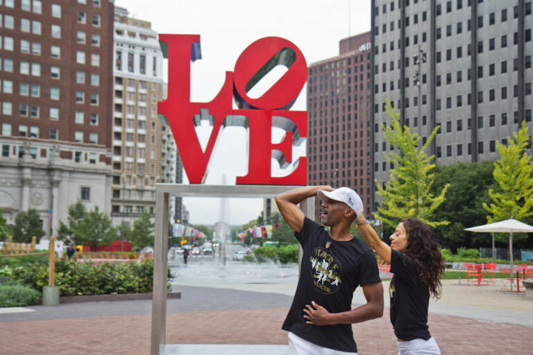 Mark 'Maestro Flaco' Best dances with Lana Corrales at Siempre Salsa's free lunch time dance lesson at LOVE Park in Center City Philadelphia. (Kimberly Paynter/WHYY)
