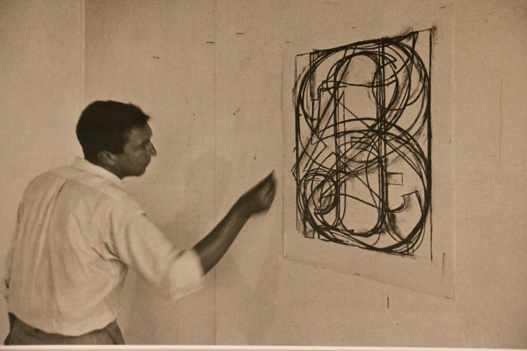A photograph by Ugo Mulas shows Jasper Johns working on ''0 through 9'' in 1965