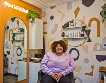 Tori McCutcheon is a curly hair stylist and owner of Tori Did That studio in Philadelphia's Head House neighborhood. (Kimberly Paynter/WHYY)