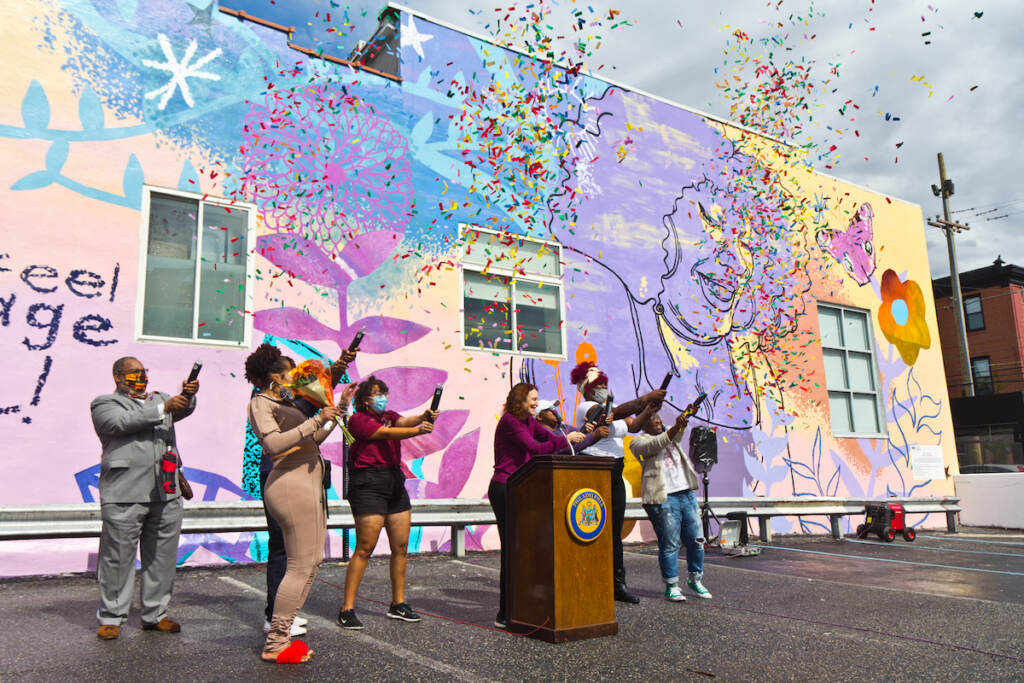 Mural Arts staff joined Morris Home residents and alumni to celebrate the dedication of We Are Universal to Philadelphia's trans community