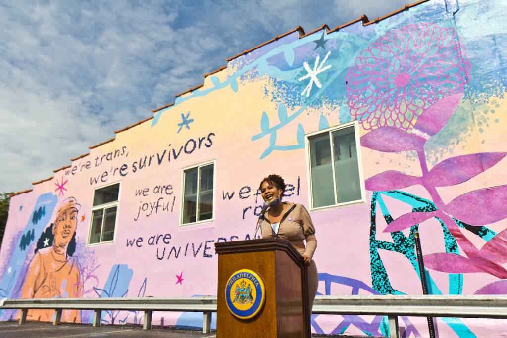 Monica Rivera, alumni of Morris Home, sang This Place, by Tamela Mann, at the mural dedication of We Are Universal to Philadelphia's trans community