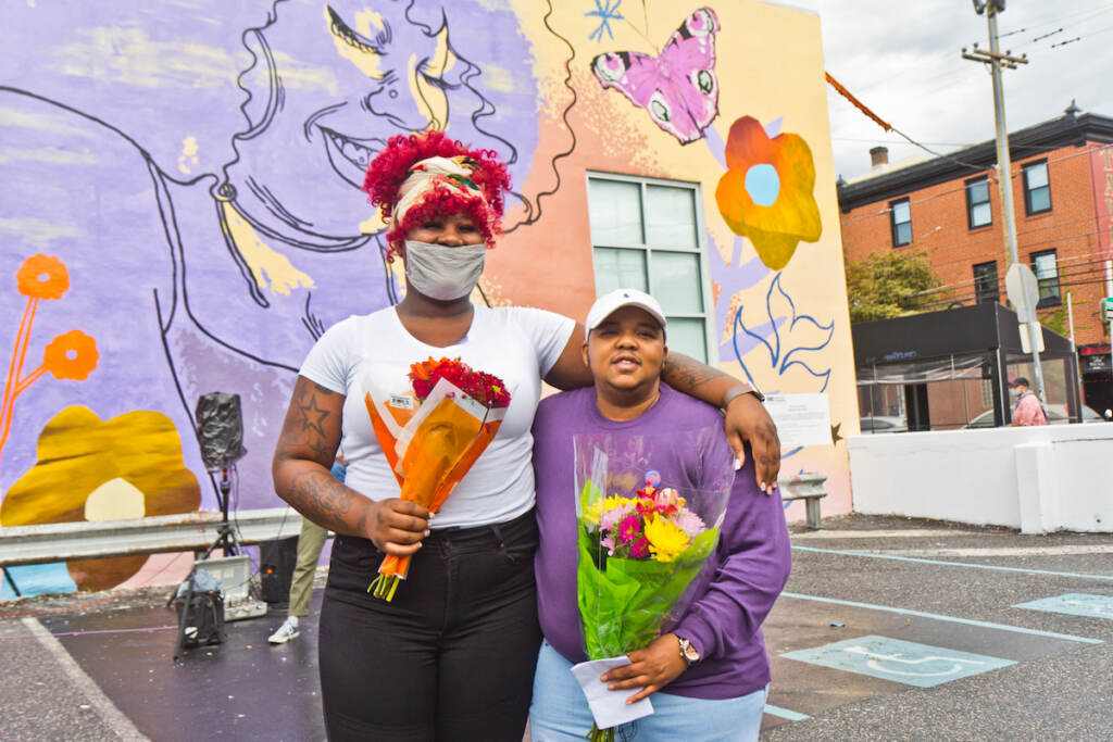 Morris Home residents Jourdyn Wood (left) and Tazmere Stephens (right) are featured in the We Are Universal mural, dedicated to Philadelphia's trans community