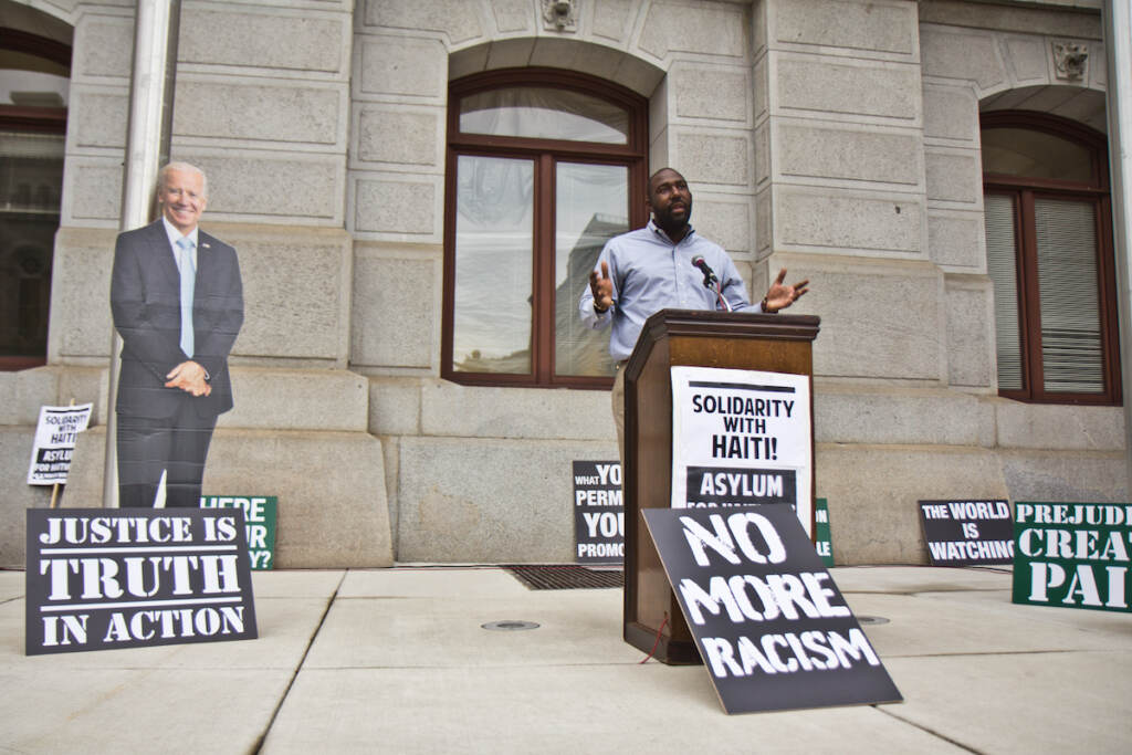 Haitian American Numa St. Louis spoke at a protest against the Biden administration's deportation of Haitian asylum-seekers, at City Hall in Philadelphia