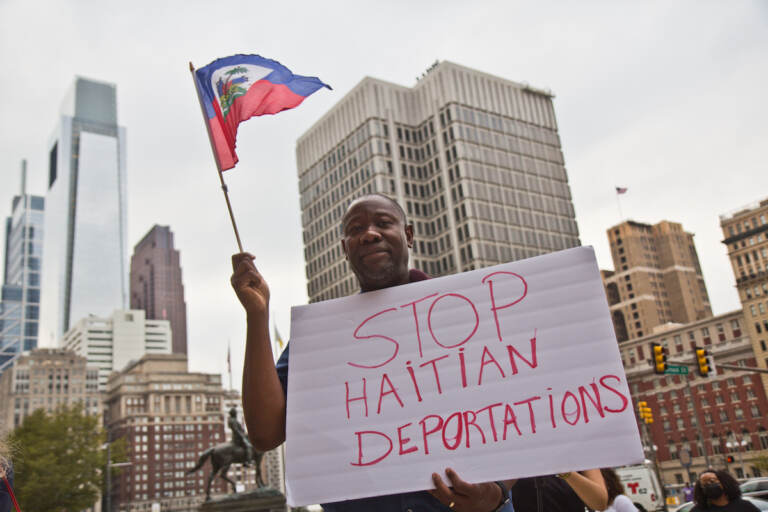 Joel Leon protested in solidarity with Haitians at the border and against the Biden administration's deportation of Haitian asylum-seekers at City Hall in Philadelphia