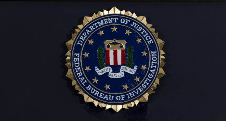 FILE PHOTO: The FBI seal is seen before a news conference at FBI headquarters in Washington on June 14, 2018. (Jose Luis Magana / AP Photo)