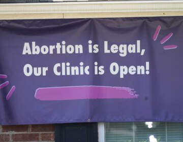 A sign hangs outside the Whole Women's Health Clinic in Fort Worth, Texas, Wednesday, Sept. 1, 2021.  (AP Photo/LM Otero)