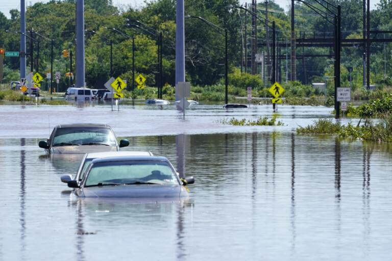 Vehicles are under water during flooding in Norristown, Pa. Thursday, Sept. 2, 2021 in the aftermath of downpours and high winds from the remnants of Hurricane Ida that hit the area. Scientists say climate change is contributing to the strength of storms like Ida. (Matt Rourke / AP Photo)