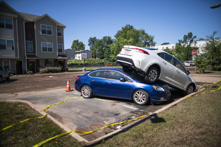 Cars are pilled after flooding as a result of the remnants of Hurricane Ida at Oakwood Plaza Apartments complex in Elizabeth, NJ., Thursday, Sept. 2, 2021. (AP Photo/Eduardo Munoz Alvarez)