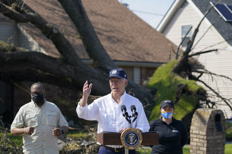 President Joe Biden talks as he tours a neighborhood impacted by Hurricane Ida, Friday, Sept. 3, 2021, in LaPlace, La.
