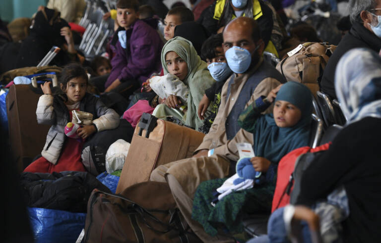 Afghan refugees are processed inside Hangar 5 at theRamstein U.S. Air Base in Germany