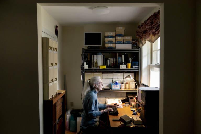 Woman poses at computer