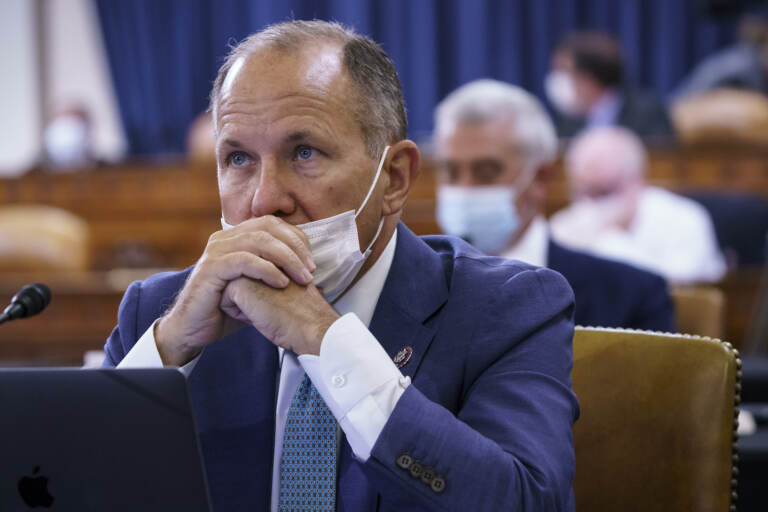 Rep. Lloyd Smucker sits with his mask below his nose at a House hearing