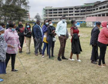 Kenyans queue up to receive the AstraZeneca coronavirus vaccine, at Kenyatta National Hospital in Nairobi, Kenya Thursday, Aug. 26, 2021