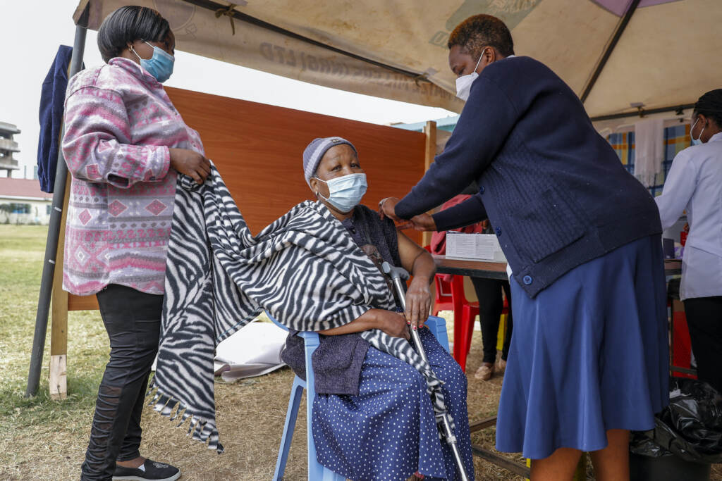 A Kenyan woman receives the AstraZeneca coronavirus vaccine at Kenyatta National Hospital in Nairobi, Kenya Thursday, Aug. 26, 2021