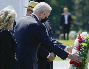 President Joe Biden and first lady Jill Biden lay a wreath at the Wall of Names during a visit to the Flight 93 National Memorial in Shanksville, Pa., Saturday, Sept. 11, 2021