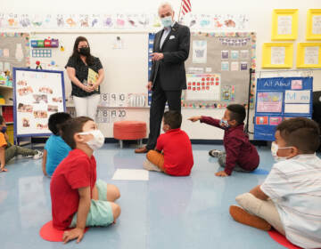 New Jersey Gov. Phil Murphy talks to three and four year old students in a pre-K class at the Dr. Charles Smith Early Childhood Center, Thursday, Sept. 16, 2021, in Palisades Park, N.J. Murphy toured the school before announcing plans to plans to provide universal pre-K for all families in New Jersey. (AP Photo/Mary Altaffer)
