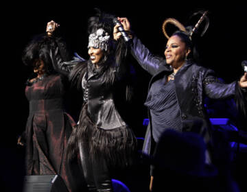 """FILE - Patti LaBelle, from left, Nona Hendryx, and Sarah Dash of the group LaBelle greet the crowd during a concert in Los Angeles on Jan. 29, 2009. Dash, who co-founded of the all-female singing group, best known for their raucous 1974 hit """"Lady Marmalade,"""" has died. She was 76. Labelle and Hendryx announced their bandmate's death Monday on social media.  (AP Photo/Matt Sayles, File)"""