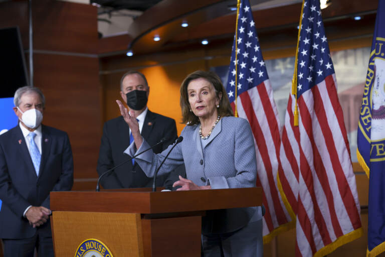 Speaker of the House Nancy Pelosi, D-Calif., joined from left by House Budget Committee Chair John Yarmuth, D-Ky., and House Intelligence Committee Chairman Adam Schiff, D-Calif., talks to reporters about the