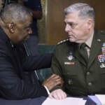 Secretary of Defense Lloyd Austin, left, and Chairman of the Joint Chiefs Chairman Gen. Mark Milley talk before a Senate Appropriations Committee hearing