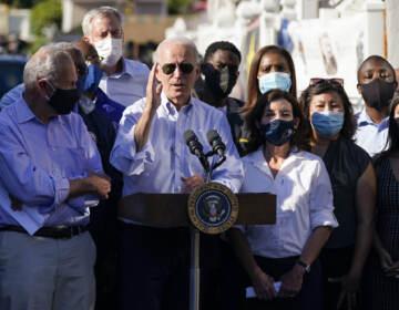 President Joe Biden speaks from a podium in Queens