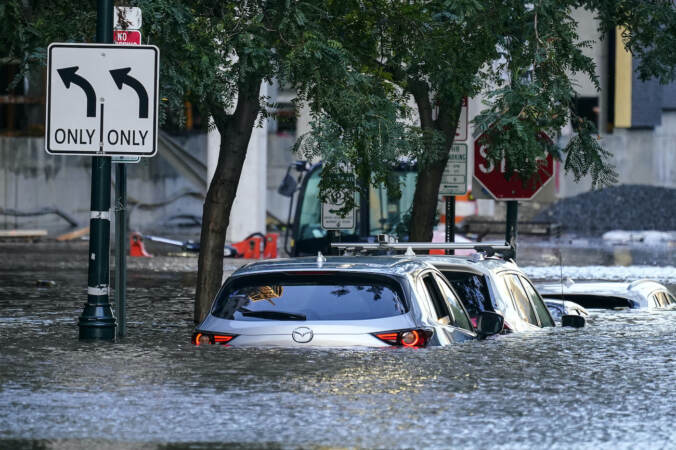Cars are seen in a flooded area of Philly