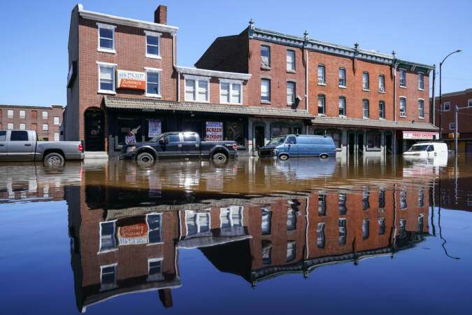Vehicles are under water during flooding on Main Street in Norristown