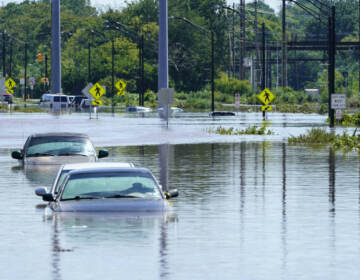 Vehicles are under water during flooding in Norristown