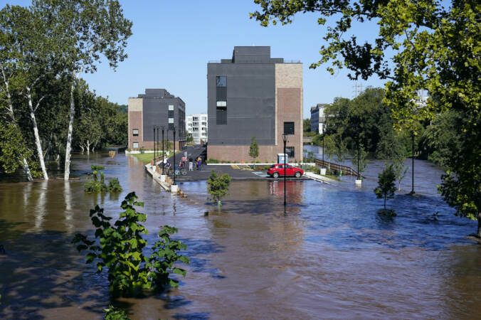 A residential building is surrounded by the floodwaters from the Schuylkill River