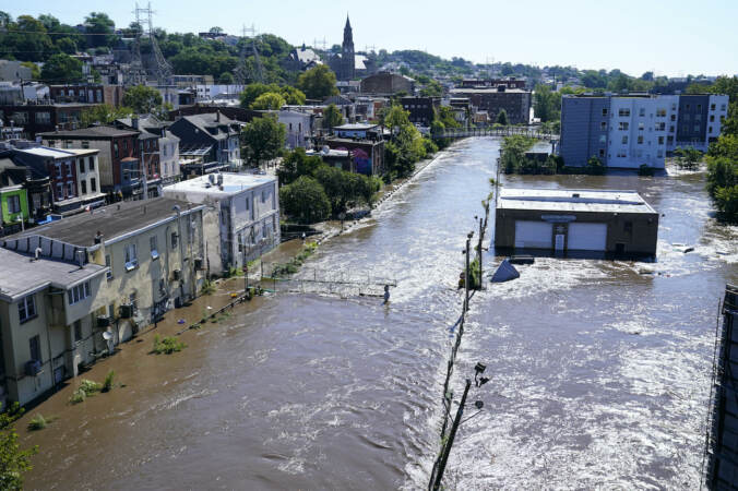 The Schuylkill River exceeds its bank in the Manayunk sectio